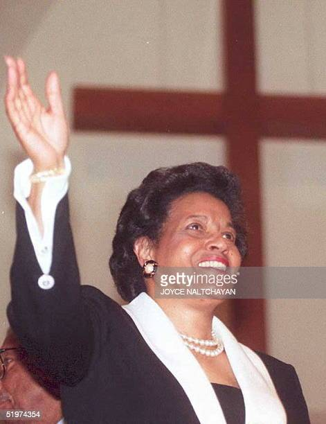 Myrlie EversWilliams widow of the slain civil rights worker Medger Evers waves to hundreds of supporters after being sworn in as the new chairwoman...