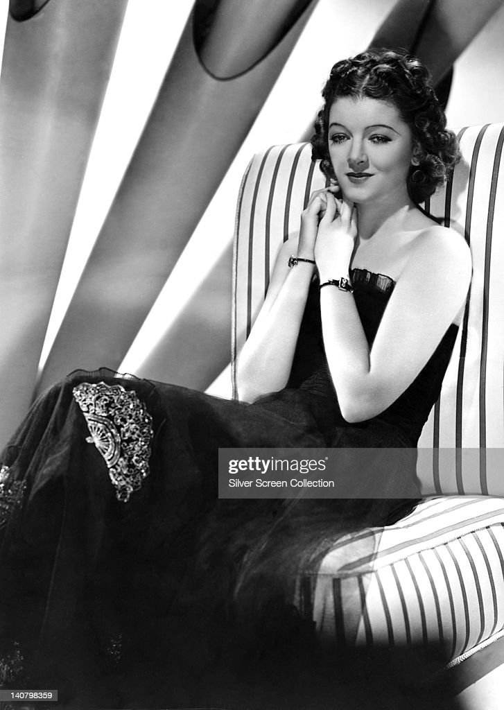 <a gi-track='captionPersonalityLinkClicked' href=/galleries/search?phrase=Myrna+Loy&family=editorial&specificpeople=93857 ng-click='$event.stopPropagation()'>Myrna Loy</a> (1905-1993), US actress, wearing shoulderless black dress, holding her hands together at her neck, in a studio portrait, circa 1930.