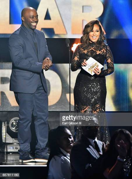 Myron Butler and Adrienne Houghton present the award for 'Choir of the Year' during the 32nd annual Stellar Gospel Music Awards at the Orleans Arena...