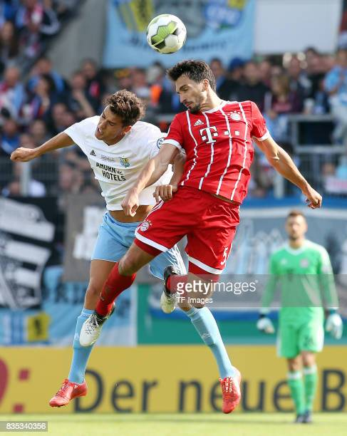 Myroslav Slavov of Chemnitz and Mats Hummels of Bayern Muenchen battle for the ball during the DFB Cup first round match between Chemnitzer FC and FC...