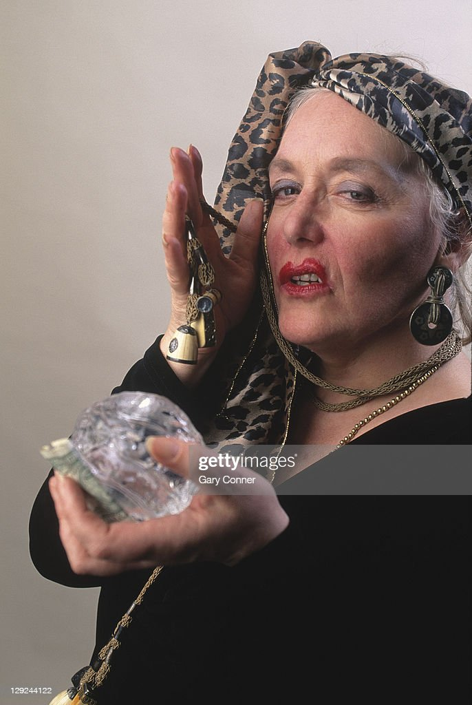 Mysterious fortune teller with crystal ball : Stock Photo