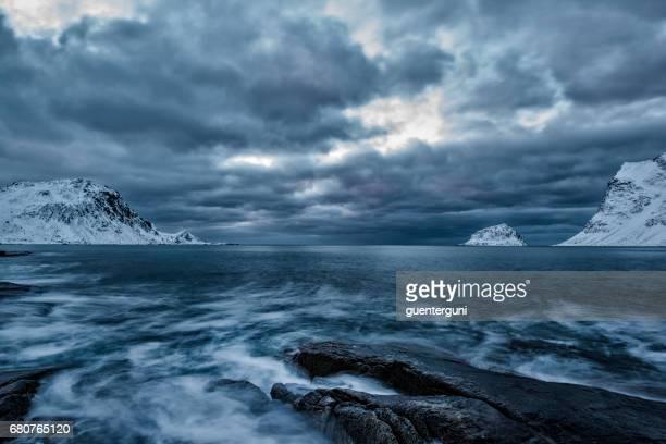 Mystic beach in winter at the nordic atlantic ocean