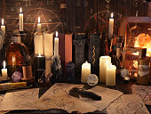 Mystic still life with magic objects, books and candles. Halloween concept, old alchemist or witch laboratory, scary ritual or spell with occult and esoteric symbols