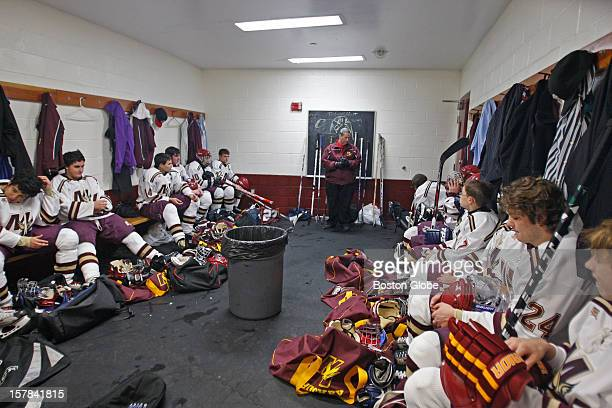 Mystic Valley High School's boys' hockey team head coach Bill Keefe pausing before talking to his team in the locker room Mystic Valley High School...