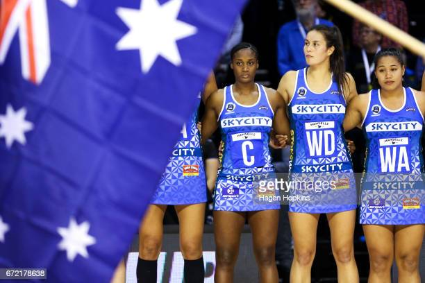 Mystics players look on while The Last Post is played in recognition of Anzac Day during the New Zealand Premiership match between the Pulse and the...