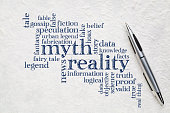 myth versus reality word cloud - handwriting on a lokta paper with a pen