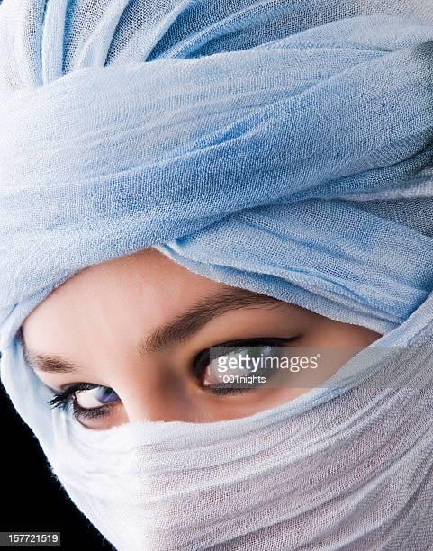 mytserious blue eyes behind tuareg