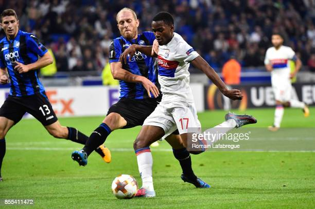 Myziane Maolida of Lyon and Andrea Masiello of Bergame during the Uefa Europa League match between Lyon and Atalante Bergame on September 28 2017 in...