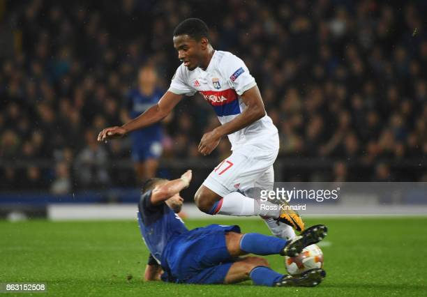 Myziane Maolida of Lyon is tackled by Morgan Schneiderlin of Everton during the UEFA Europa League Group E match between Everton FC and Olympique...