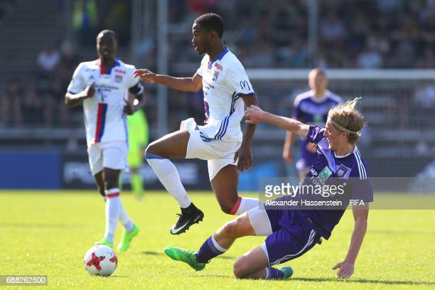 Myziane Maolida of Olympique Lyonnais is challenged by Sebastiaan Bornauw of RSC Anderlecht during the Final match between Olympique Lyon vs RSC...