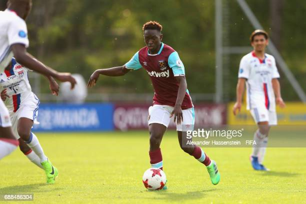 Myziane Maolida of West Ham runs with the ball duirng the 1st round match between West Ham United and Olympique Lyon on day one of the Blue...
