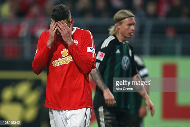 mz28 of Mainz reacts as he walks past Simon Kjaer of Wolfsburg during the Bundesliga match between FSV Mainz 05 and VfL Wolfsburg at Bruchweg Stadium...