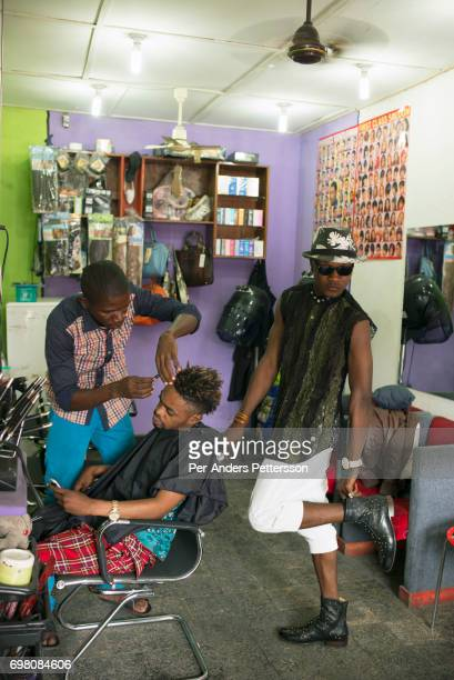 Mzee Kindingu the leader of the Sapeurs group The Leopards has a haircut in a salon bedroom on February 3 2015 in Kinshasa DRC The word Sapeur comes...