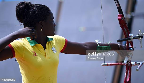 Zinsou of Benin shoots during practice of Archery training at the Fangshan Archery Ground during Day 6 of the Nanjing 2014 Summer Youth Olympic Games...