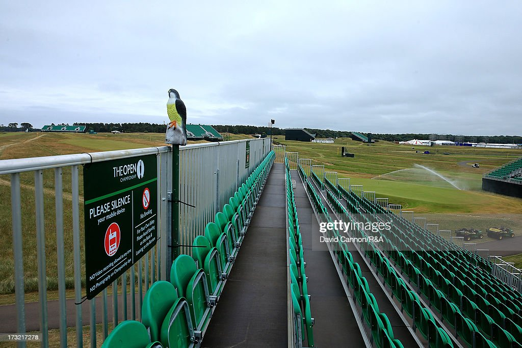 A n immitation hawk used to stop birds nesting on the grandstand behind the 4th hole as the spriklers are seen watering the 12th green area as a preview for the 2013 Open Championship at Muirfield on July 10, 2013 in Gullane, Scotland.