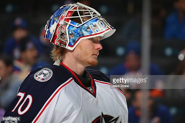 'n Joonas Korpisalo of the Columbus Blue Jackets defend against the New York Islanders at the Barclays Center on January 24 2017 in Brooklyn borough...
