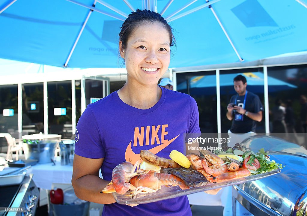 Na Li of China barbeques prawns in the players' cafe during day eight of the 2013 Australian Open at Melbourne Park on January 22, 2013 in Melbourne, Australia.