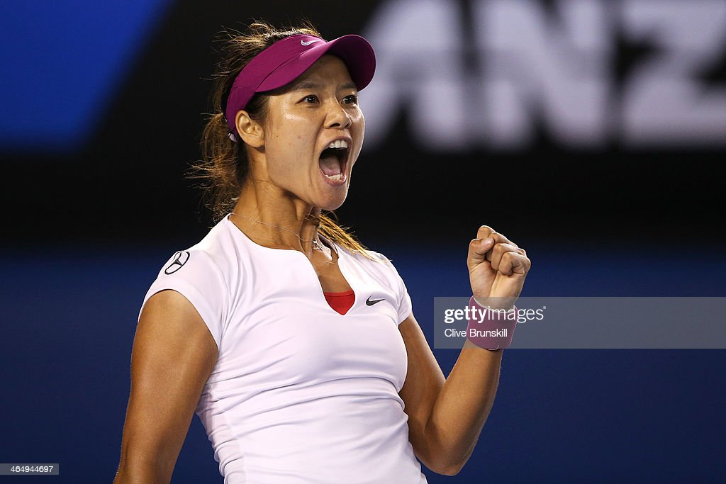 Na Li of China celebrates winning the first set in her women's final match against Dominika Cibulkova of Slovakia during day 13 of the 2014 Australian Open at Melbourne Park on January 25, 2014 in Melbourne, Australia.