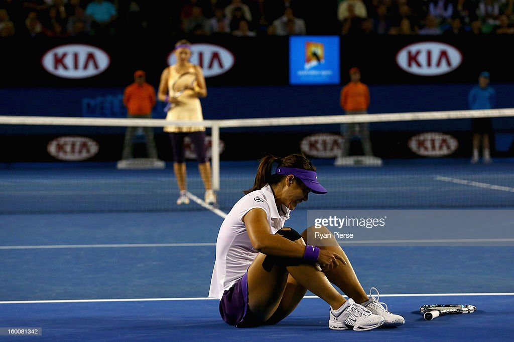 Na Li of China falls and appears to injure her ankle in her women's final match against Victoria Azarenka of Belarus during day thirteen of the 2013 Australian Open at Melbourne Park on January 26, 2013 in Melbourne, Australia.