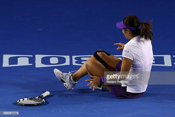 Na Li of China falls and injures her ankle in her women's final match against Victoria Azarenka of Belarus during day thirteen of the 2013 Australian...