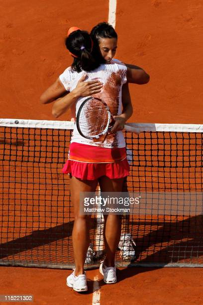 Na Li of China is hugged by Francesca Schiavone of Italy following her victory during the women's singles final match between Francesca Schiavone of...