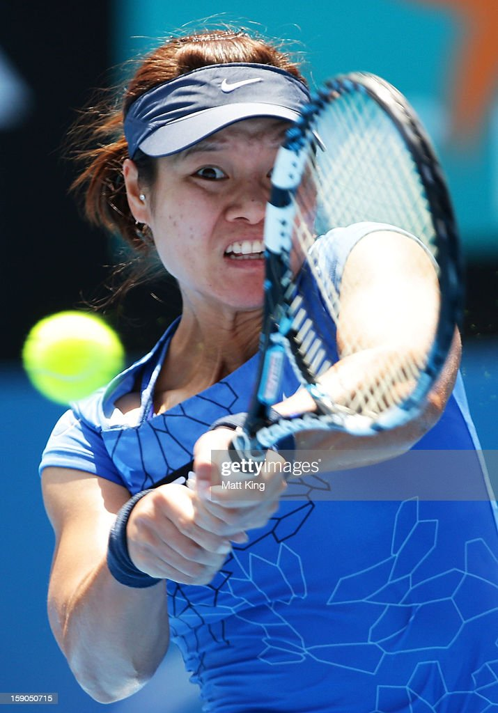 Na Li of China plays a backhand in her first round match against Christina McHale of USA during day two of the Sydney International at Sydney Olympic Park Tennis Centre on January 7, 2013 in Sydney, Australia.