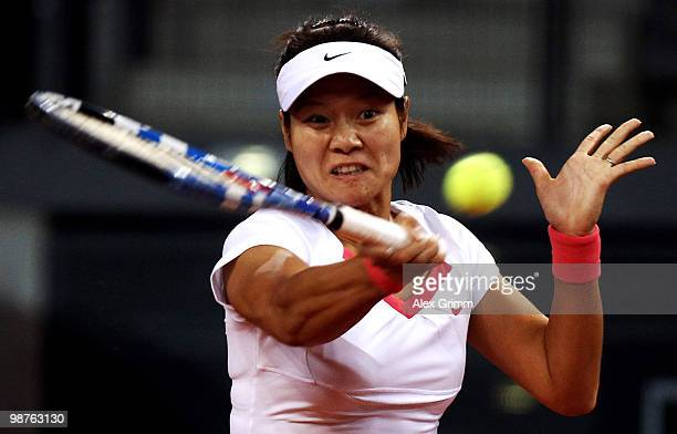 Na Li of China plays a forehand during her quarterfinal match against Samantha Stosur of Australia at day five of the WTA Porsche Tennis Grand Prix...
