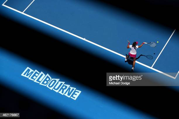 Na Li of China plays a forehand in her first round match against Ana Konjuh of Croatia during day one of the 2014 Australian Open at Melbourne Park...