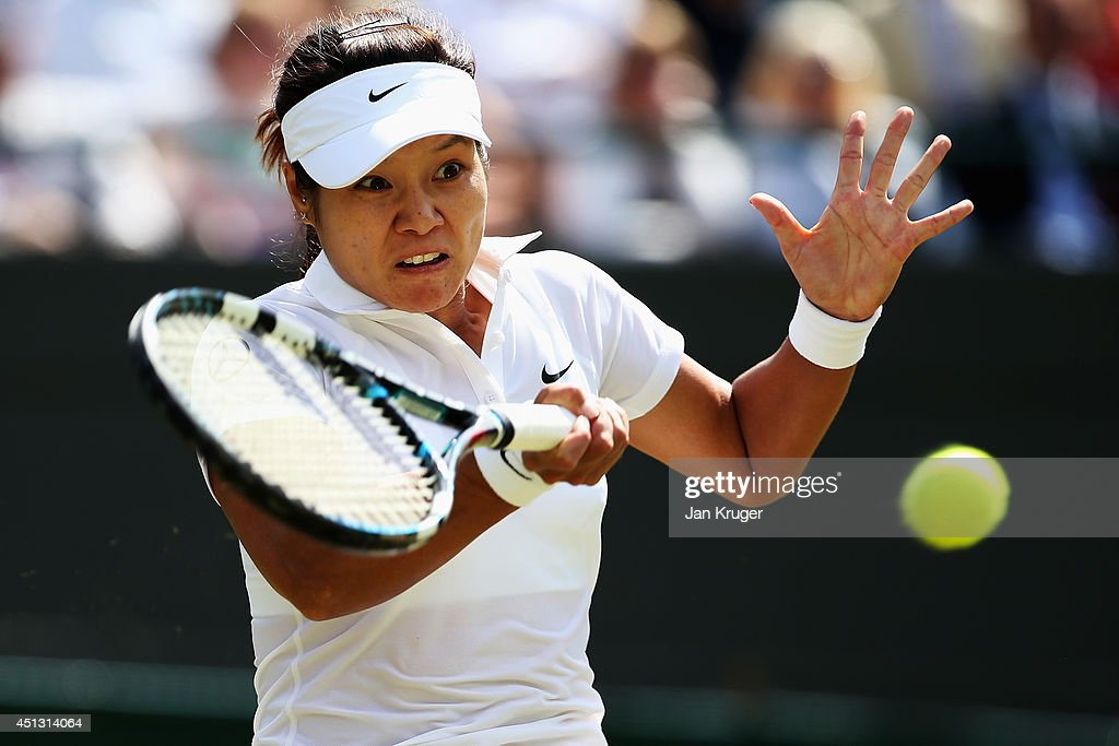Na Li of China plays a forehand return during the Ladies' Singles third round match Barbora Zahlavova Strycova of Czech Republic on day five of the Wimbledon Lawn Tennis Championships at the All England Lawn Tennis and Croquet Club on June 27, 2014 in London, England.