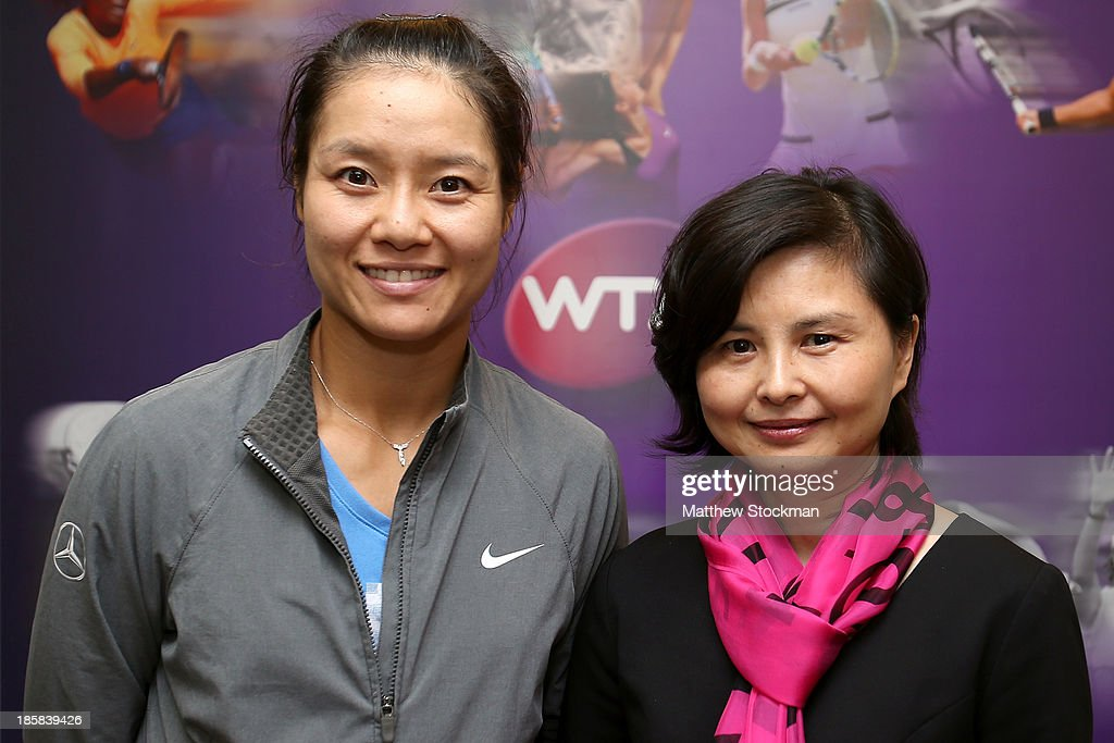 Na Li of China poses for a picture with Wuhan, China Vice Mayor Liu Yingzi during day three of the TEB BNP Paribas WTA Championships at the Sinan Erdem Dome on October 24, 2013 in Istanbul, Turkey.