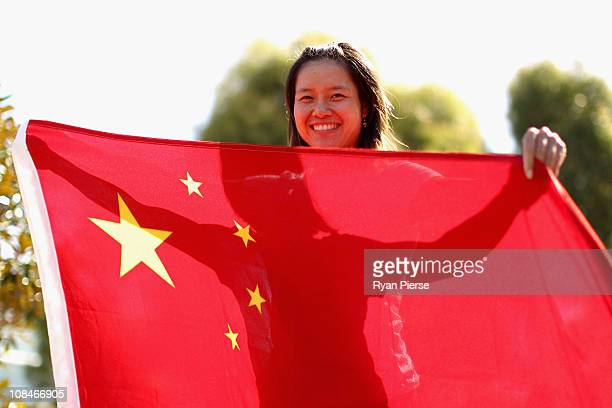 Na Li of China poses with the Chinese flag during day twelve of the 2011 Australian Open at Melbourne Park on January 28 2011 in Melbourne Australia