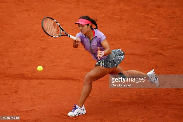 Na Li of China returns a shot during her women's singles match against Kristina Mladenovic of France on day three of the French Open at Roland Garros...