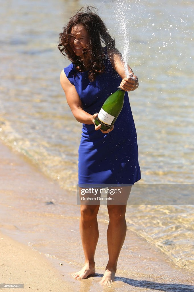 Na Li of China sprays champagne at Brighton Beach, after winning the 2014 Australian Open, on January 26, 2014 in Melbourne, Australia.