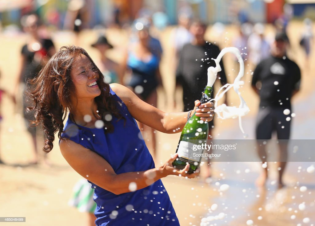 <a gi-track='captionPersonalityLinkClicked' href=/galleries/search?phrase=Na+Li+-+Tennisspieler&family=editorial&specificpeople=4485174 ng-click='$event.stopPropagation()'>Na Li</a> of China sprays champagne during a photocall at Brighton Beach after winning the 2014 Australian Open on January 26, 2014 in Melbourne, Australia.