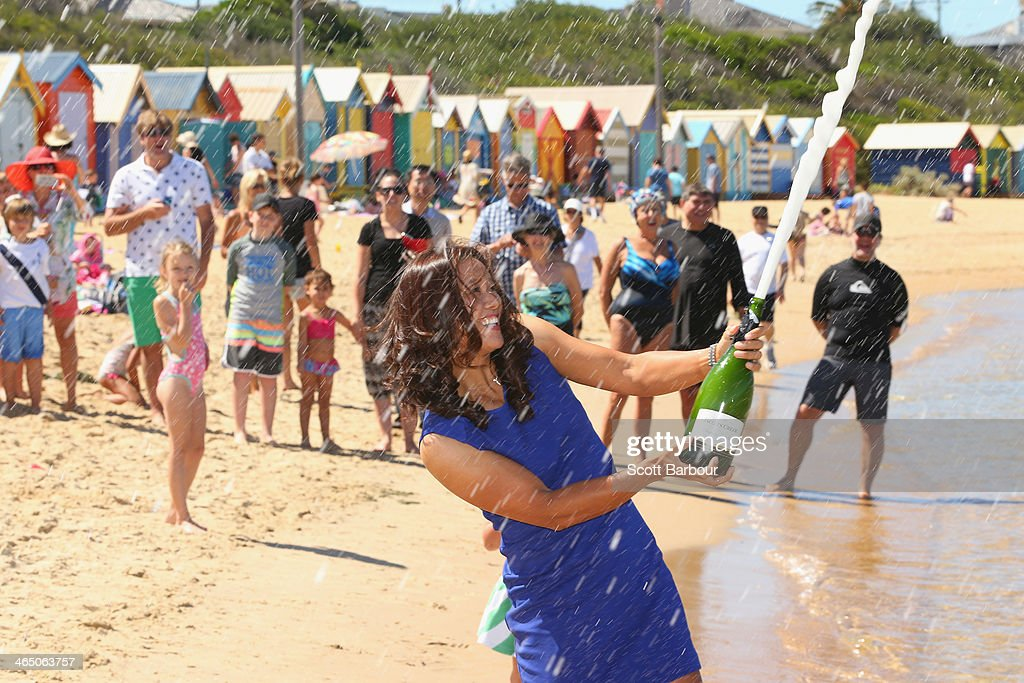 Na Li of China sprays champagne during a photocall at Brighton Beach after winning the 2014 Australian Open on January 26, 2014 in Melbourne, Australia.