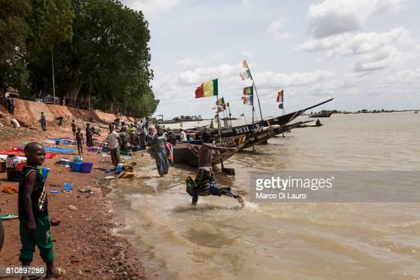 'nA Malian girls jumps around as she bath herself on the river banks of the Niger on August 6 2013 in Mopti Mali'nIn January 2012 a Tuareg rebellion...