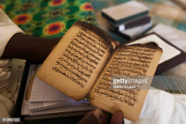'nA manuscripts expert holds a manuscript that was burn by the Islamist rebels at the Ahmed Baba Institute on August 12 2013 in Timbuktu Mali'nIn...