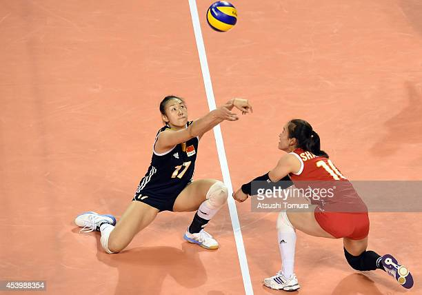 Na Wang and Danna Shan of China receive the ball during the FIVB World Grand Prix Final group one match between Turkey and China on August 23 2014 in...
