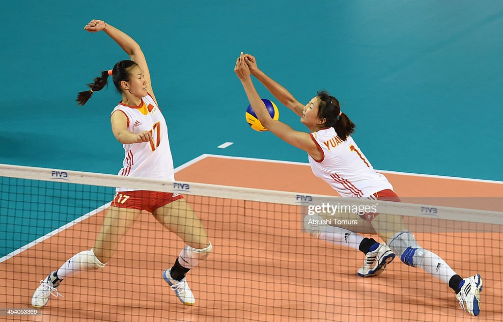 Na Wang (L) and Xinyue Yuan (R) of China loose a point during the FIVB World Grand Prix Final group one match between Russia and China on August 24, 2014 in Tokyo, Japan.