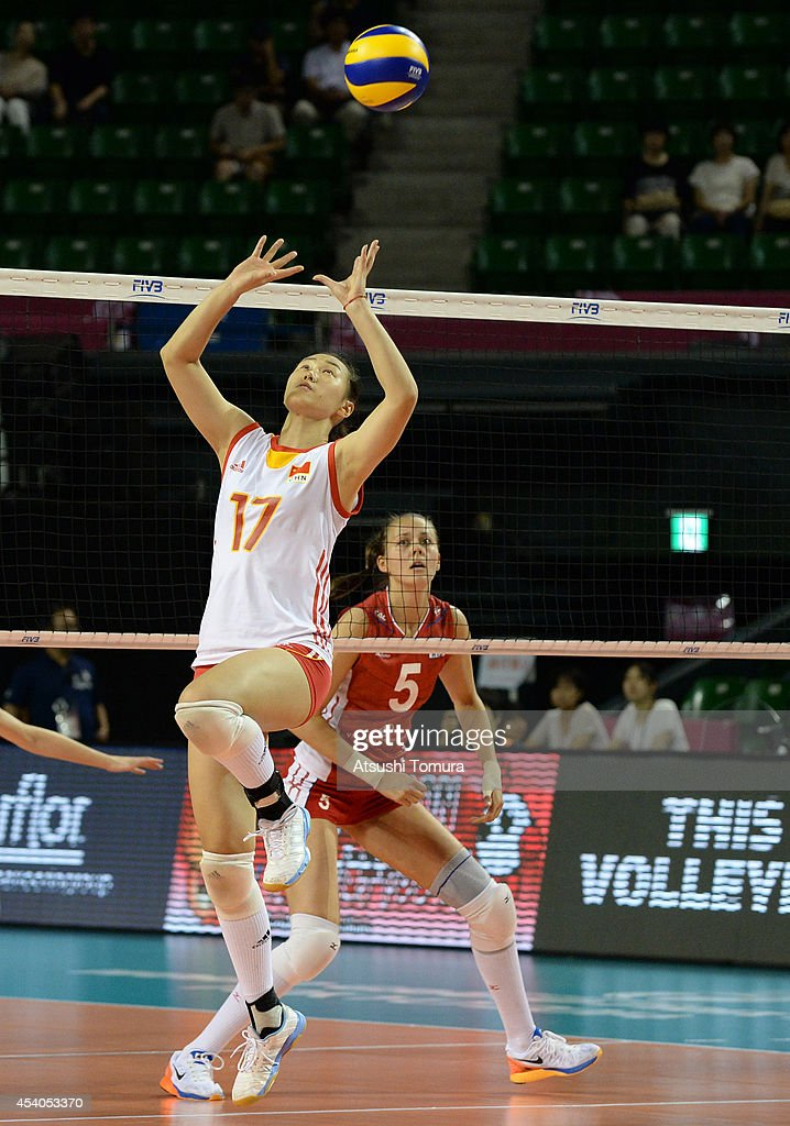 Na Wang of China setting up during the FIVB World Grand Prix Final group one match between Russia and China on August 24, 2014 in Tokyo, Japan.