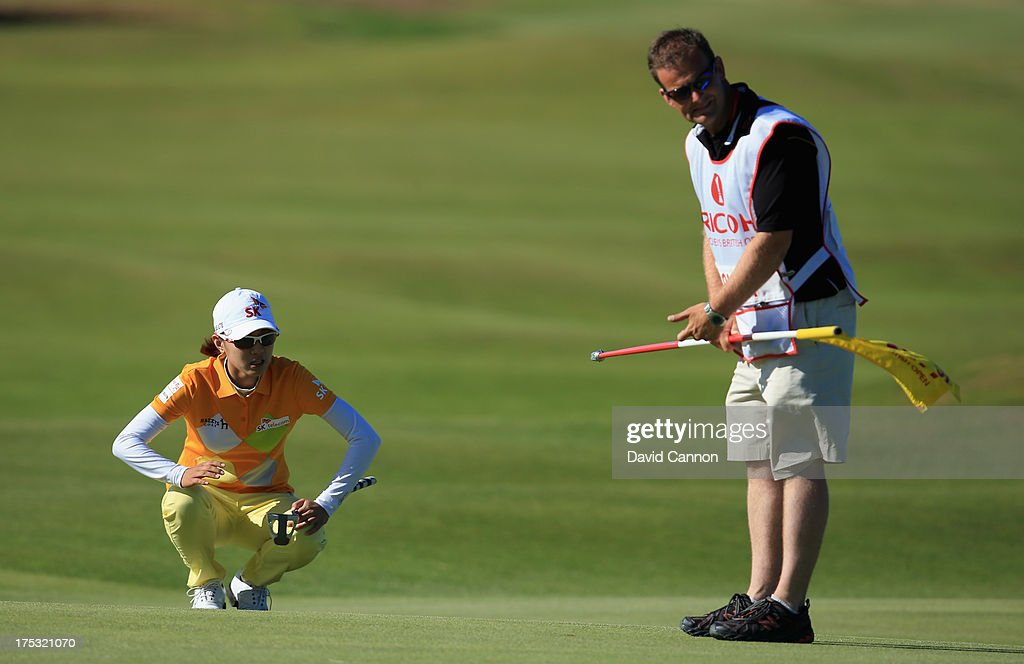 <a gi-track='captionPersonalityLinkClicked' href=/galleries/search?phrase=Na+Yeon+Choi&family=editorial&specificpeople=4979078 ng-click='$event.stopPropagation()'>Na Yeon Choi</a> of Korea lines up with her caddie on the 16th green during the second round of the Ricoh Women's British Open at the Old Course, St Andrews on August 2, 2013 in St Andrews, Scotland.