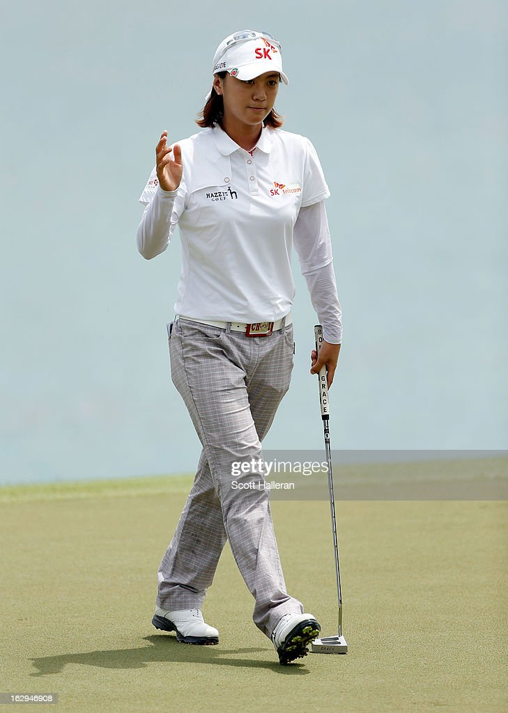 Na Yeon Choi of South Korea acknowledges the crowd during the third round of the HSBC Women's Champions at the Sentosa Golf Club on March 2, 2013 in Singapore, Singapore.