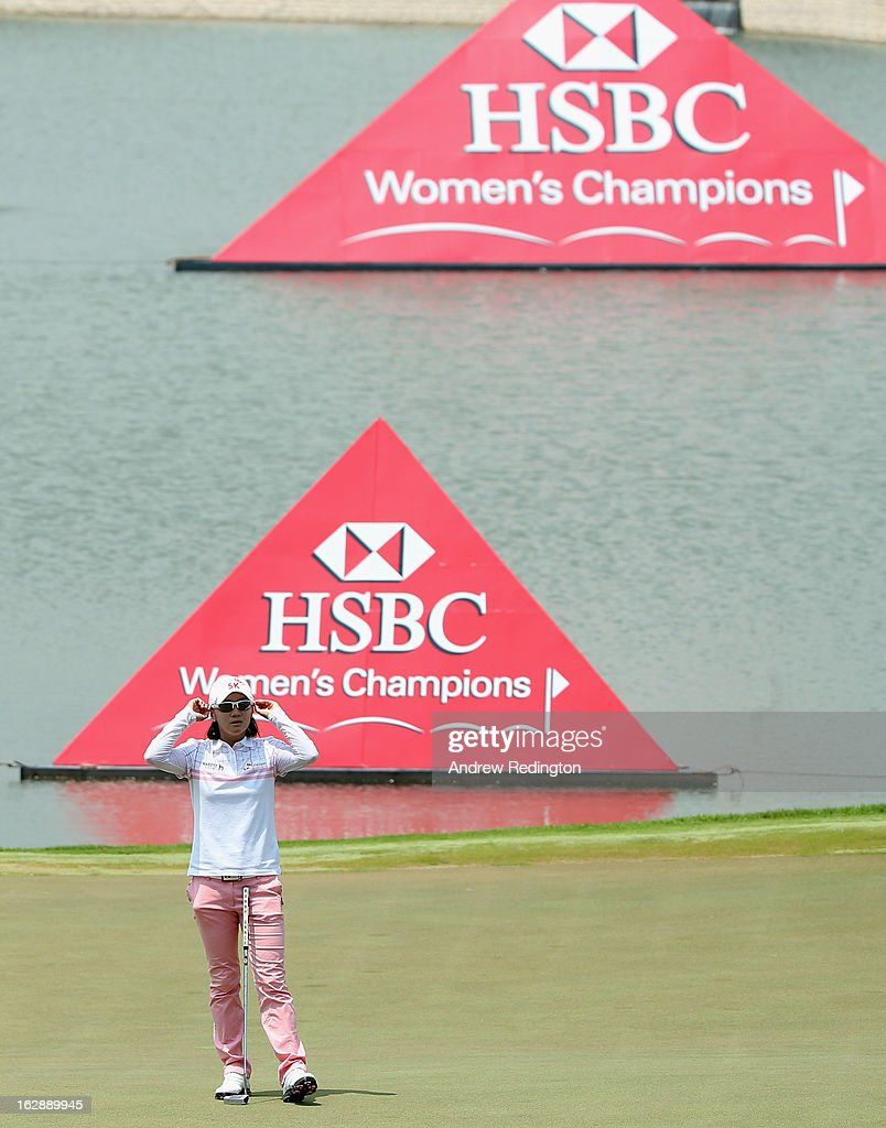 Na Yeon Choi of South Korea adjusts her sunglasses on the 18th hole during the second round of the HSBC Women's Champions at the Sentosa Golf Club on March 1, 2013 in Singapore, Singapore.