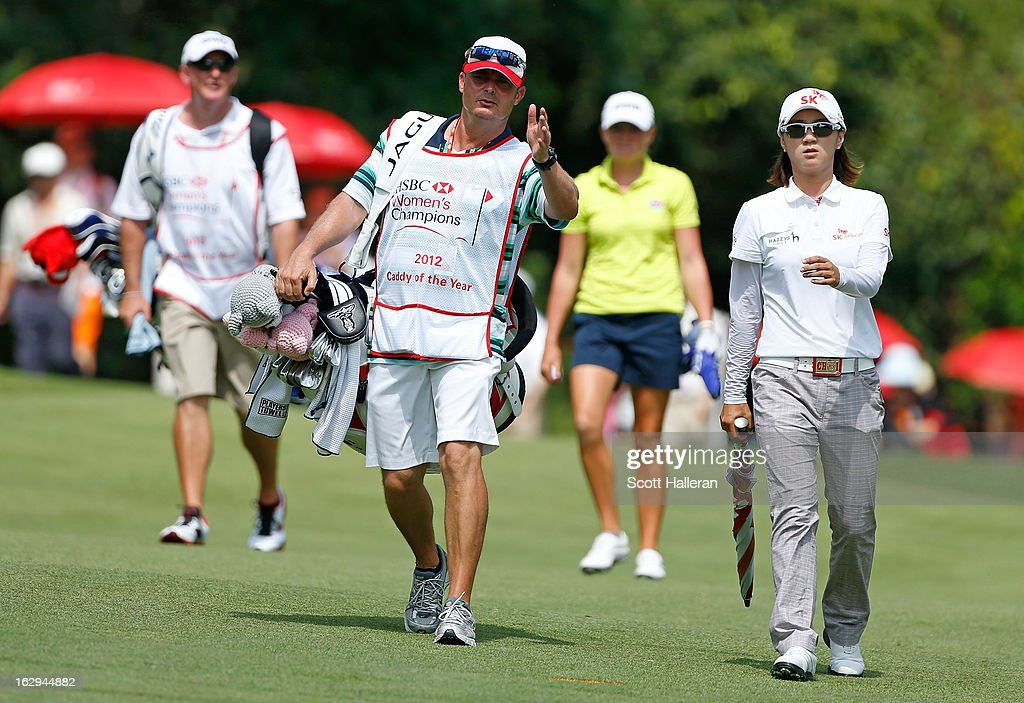 Na Yeon Choi of South Korea chats with her caddie Jason Hamilton during the third round of the HSBC Women's Champions at the Sentosa Golf Club on March 2, 2013 in Singapore, Singapore.