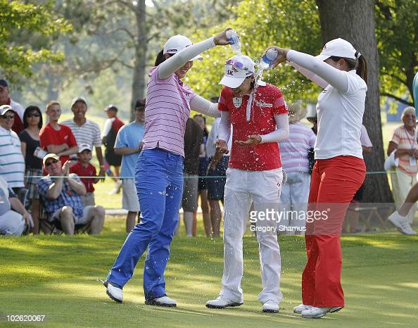 Na Yeon Choi of South Korea has water poured in her by Inbee Kim and Meena Lee both of South Korea after whe won the Jamie Farr Owens Corning Classic...