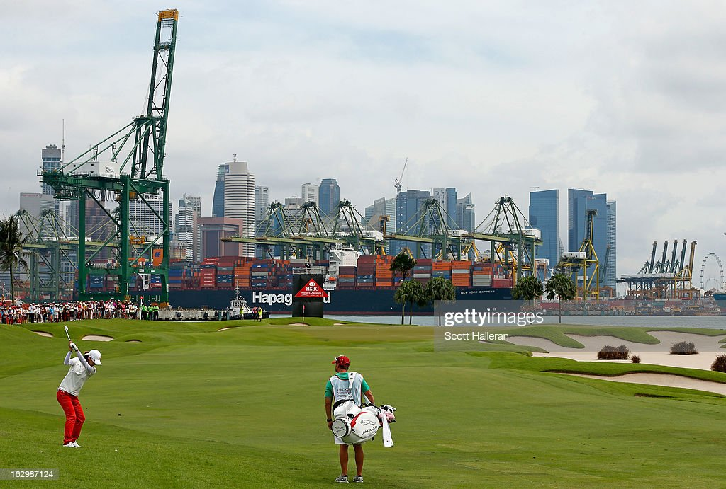 Na Yeon Choi of South Korea hits her approach to the 6th hole during the final round of the HSBC Women's Champions at the Sentosa Golf Club on March 3, 2013 in Singapore, Singapore.