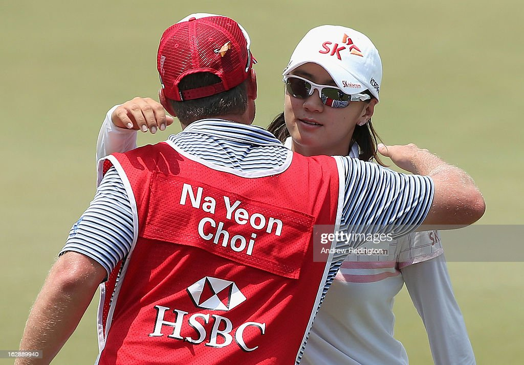 Na Yeon Choi of South Korea hugs her caddie on the 18th hole during the second round of the HSBC Women's Champions at the Sentosa Golf Club on March 1, 2013 in Singapore, Singapore.