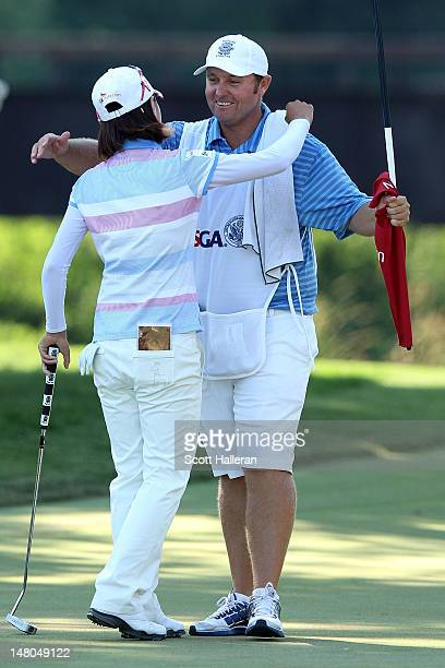 Na Yeon Choi of South Korea hugs her caddie Shane Joel on the 18th green after her fourstroke victory at the 2012 US Women's Open on July 8 2012 at...