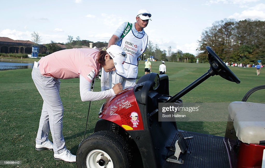 <a gi-track='captionPersonalityLinkClicked' href=/galleries/search?phrase=Na+Yeon+Choi&family=editorial&specificpeople=4979078 ng-click='$event.stopPropagation()'>Na Yeon Choi</a> of South Korea signs a golf cart on the 17th hole in memory of longtime rules official Doug Brecht who died after a three-month battle with the West Nile virus, during the third round of the CME Group Titleholders at the TwinEagles Club on November 17, 2012 in Naples, Florida.