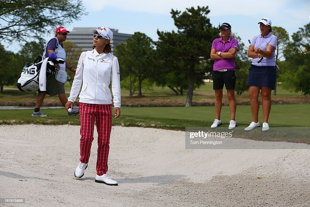 Na Yeon Choi of South Korea waits for a rules official as Becky Morgan and Angela Stanford look on on the 15th hole during the third round of the 2013 North Texas LPGA Shootout at the Las Colinas Country Club on April 27, 2013 in Irving, Texas.